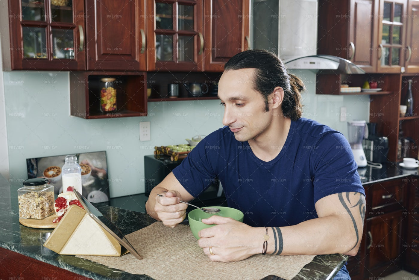 Man Having Breakfast In The Kitchen: Stock Photos