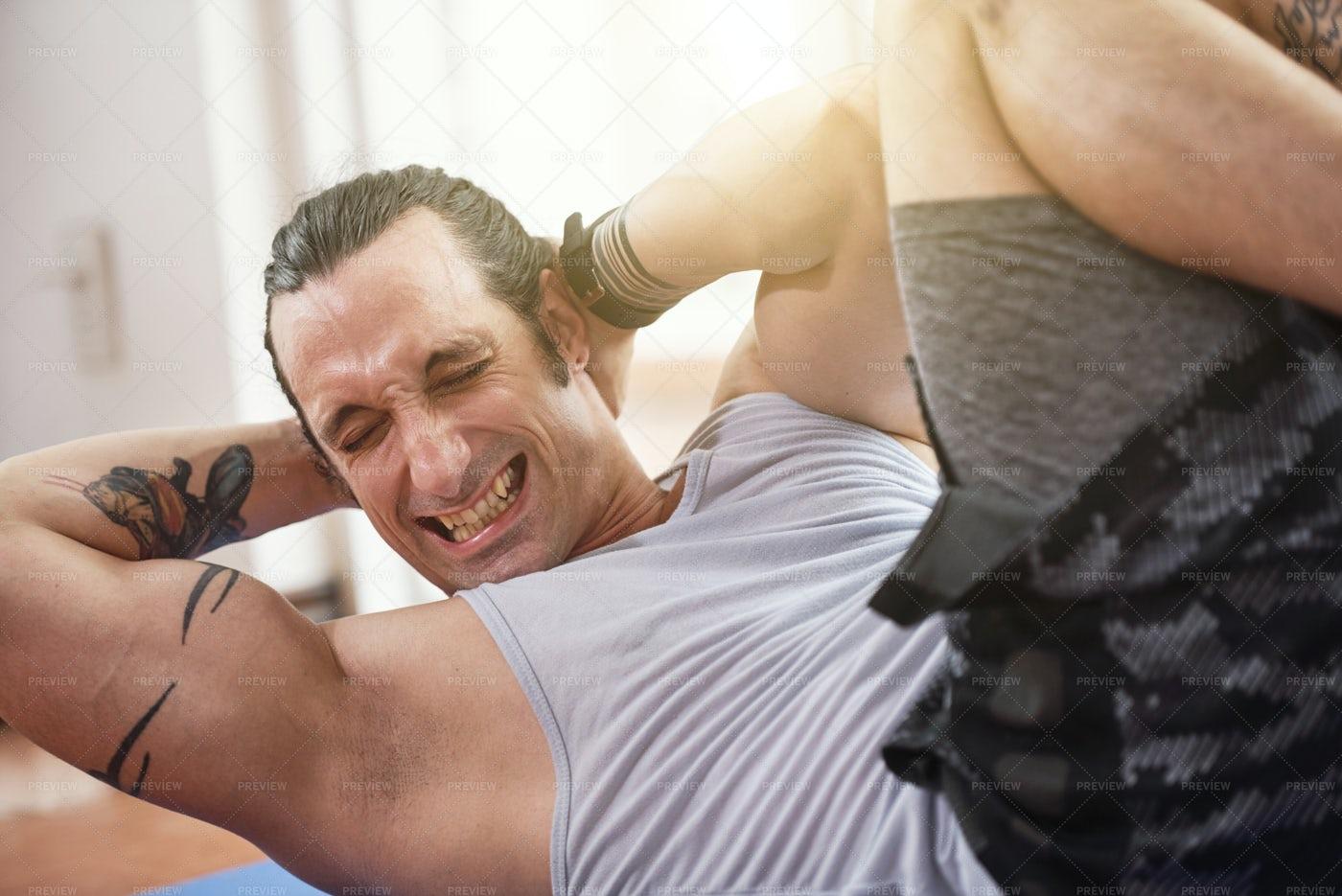 Man Struggles To Do Sit-ups: Stock Photos