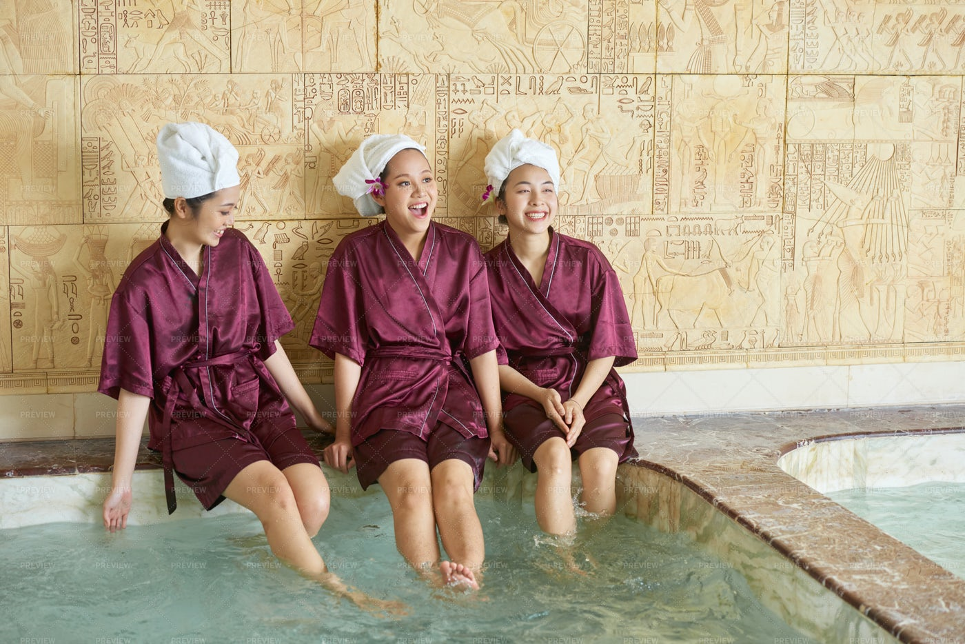 Female Friends Relaxing In The Pool: Stock Photos