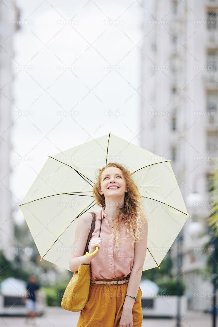 Happy Girl Walking With Umbrella: Stock Photos
