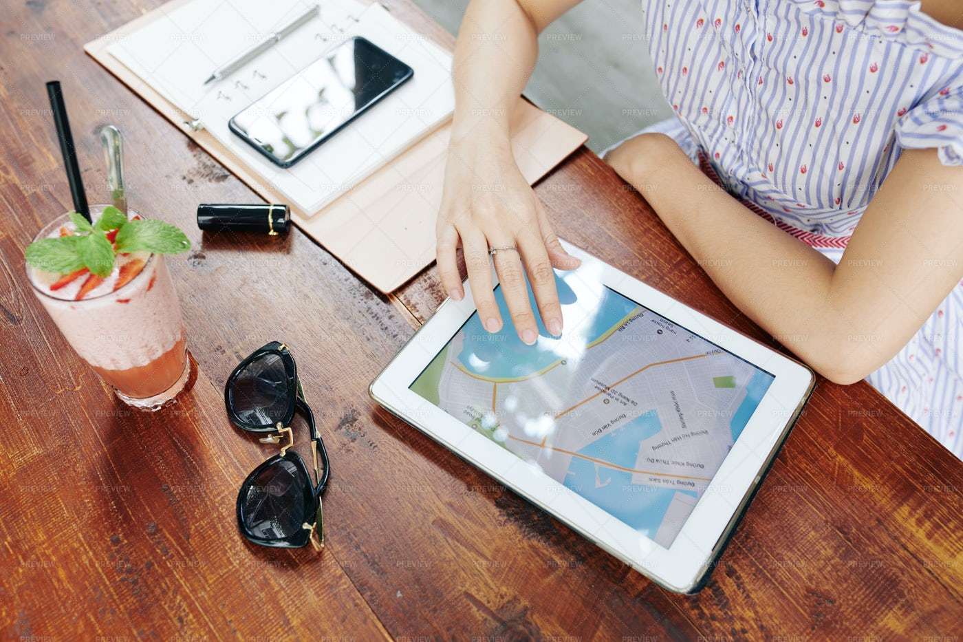 Woman Using Map On Tablet: Stock Photos