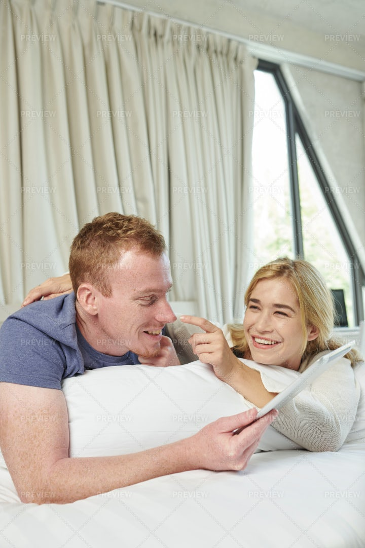 Happy Couple Resting In Bed: Stock Photos