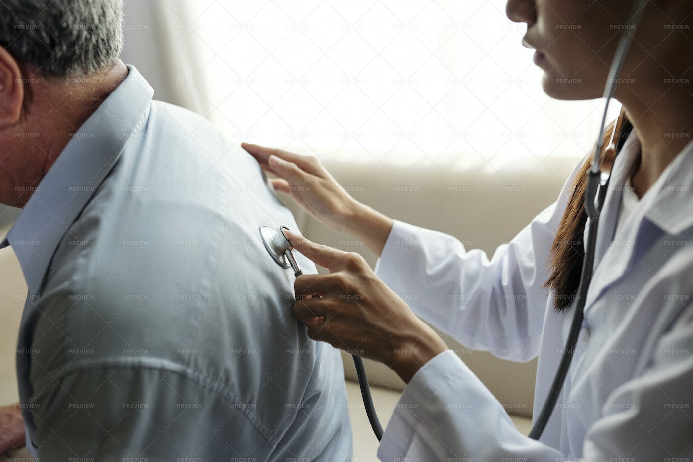 Doctor Examining The Patient With: Stock Photos
