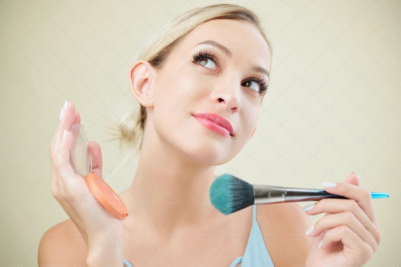 Pretty Woman Applying Blush: Stock Photos