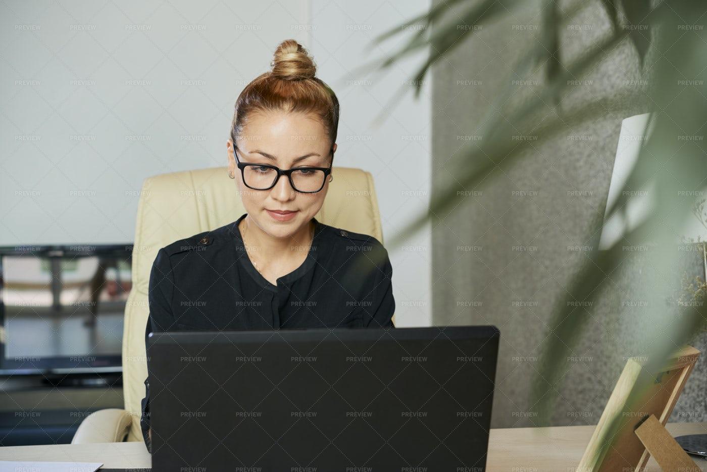 Businesswoman Reading E-mail On Laptop: Stock Photos