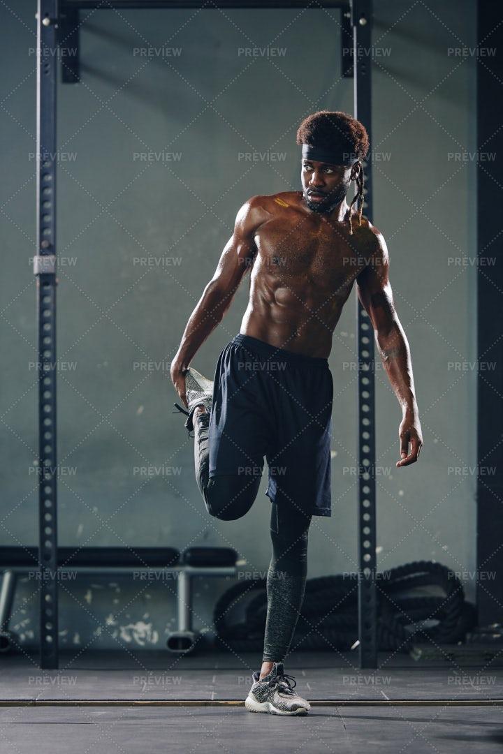 Man Stretching Quads: Stock Photos