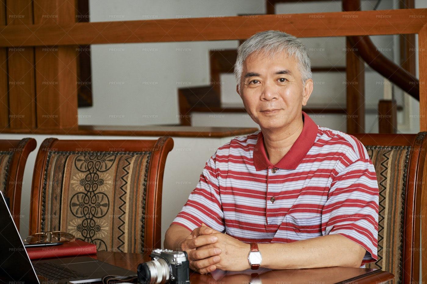 Asian Man Working At Home: Stock Photos