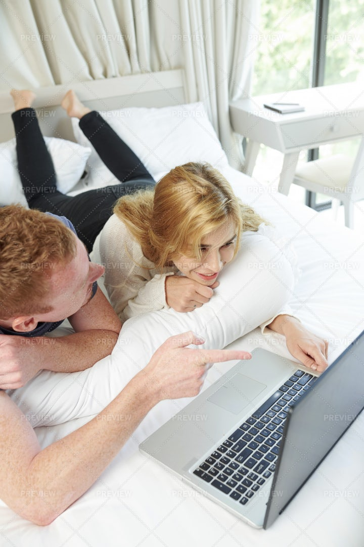 Couple Watching Movie Online: Stock Photos