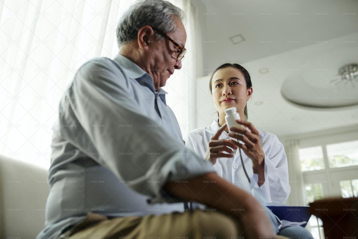 Doctor Prescribing A Medicine: Stock Photos