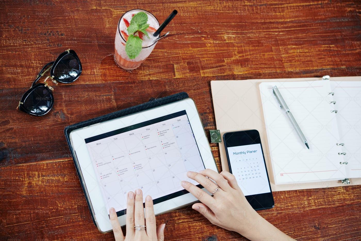 Woman Checking Planner App: Stock Photos