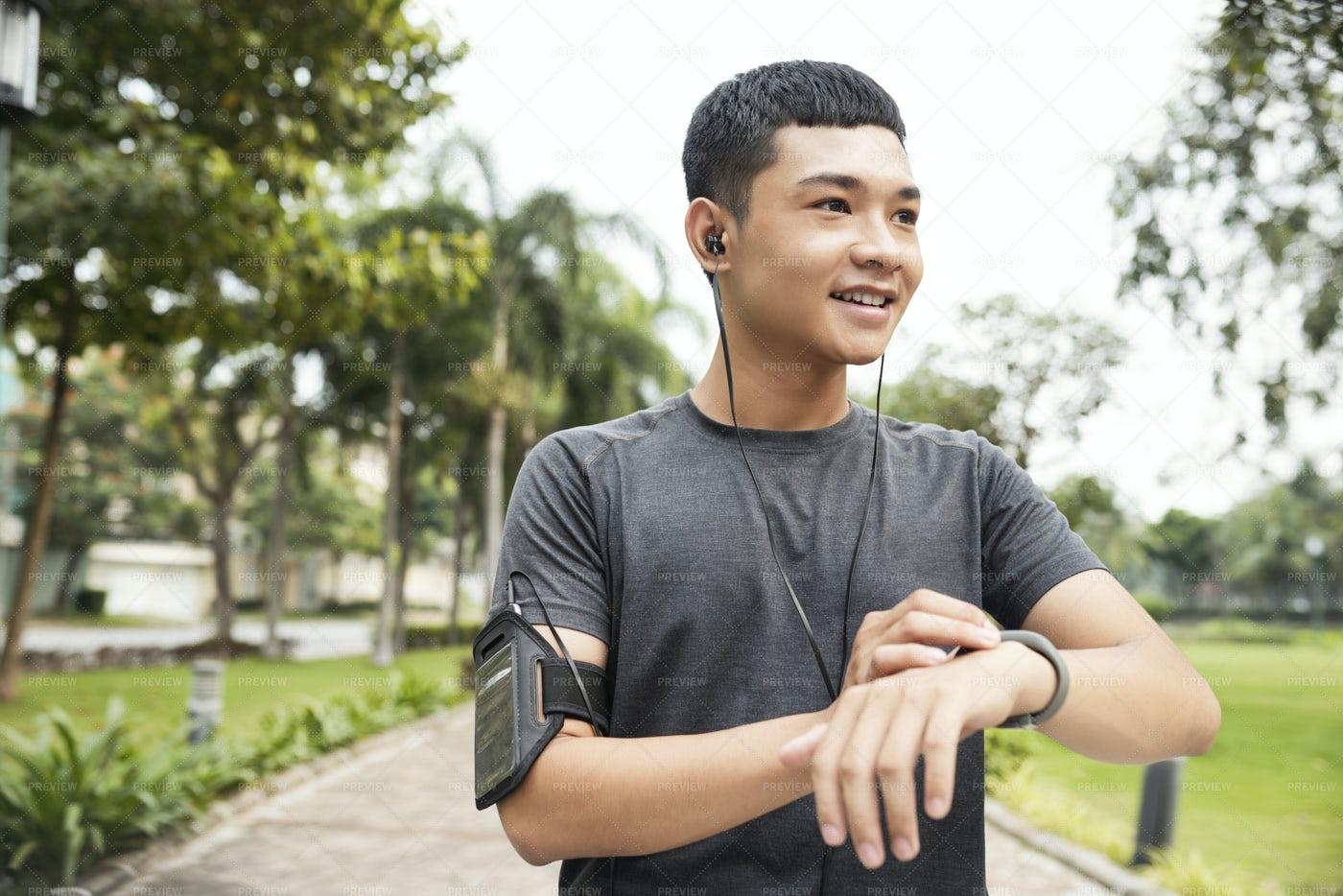 Man Setting Fitness Tracker: Stock Photos