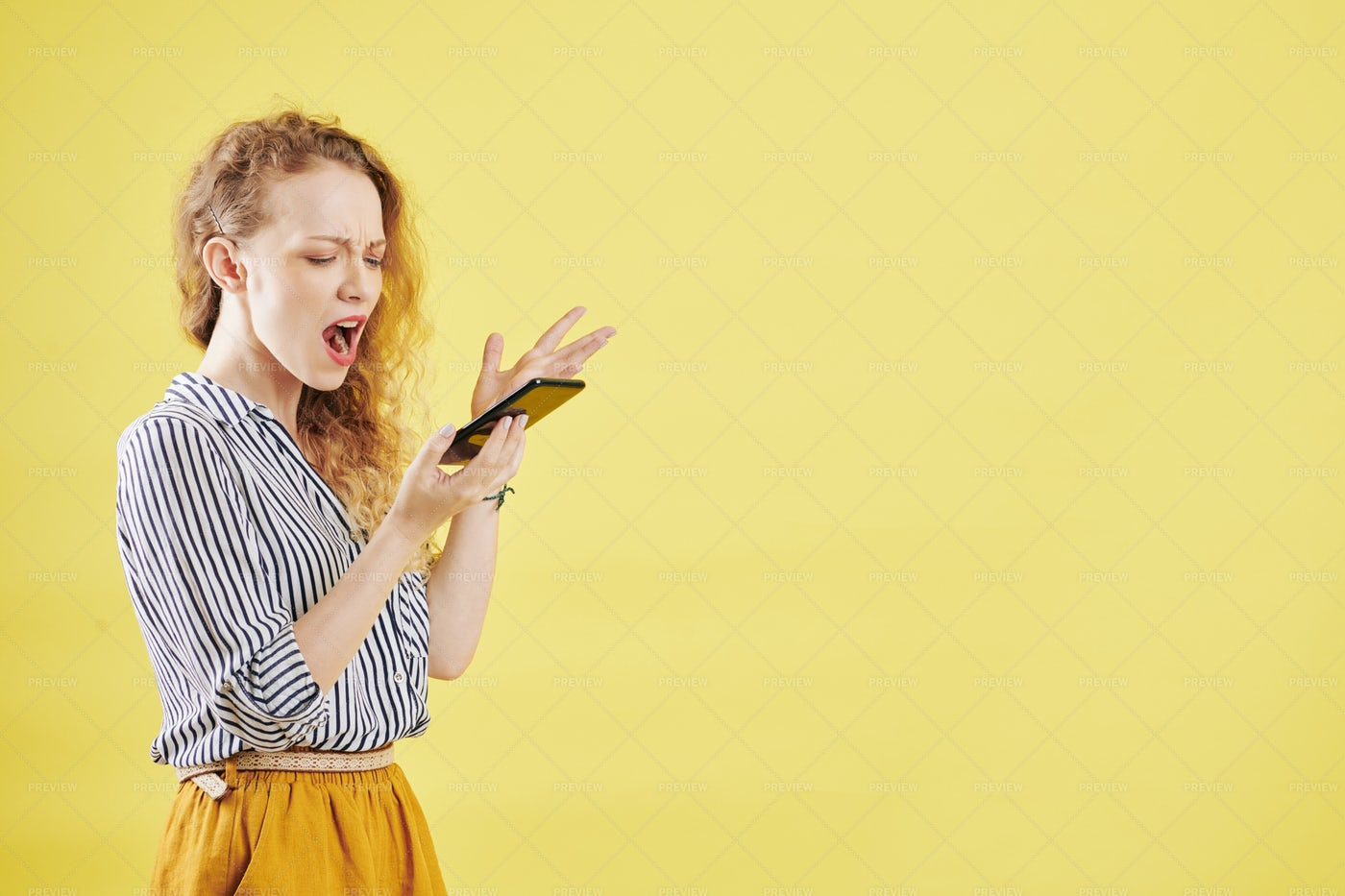 Indignant Woman Reading Text Message: Stock Photos