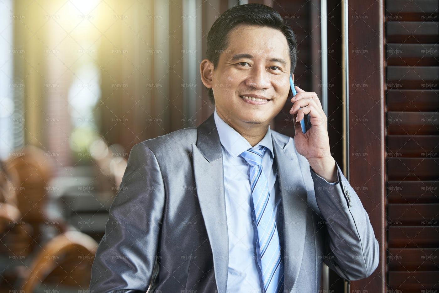 Businessman Talking On Mobile Phone: Stock Photos