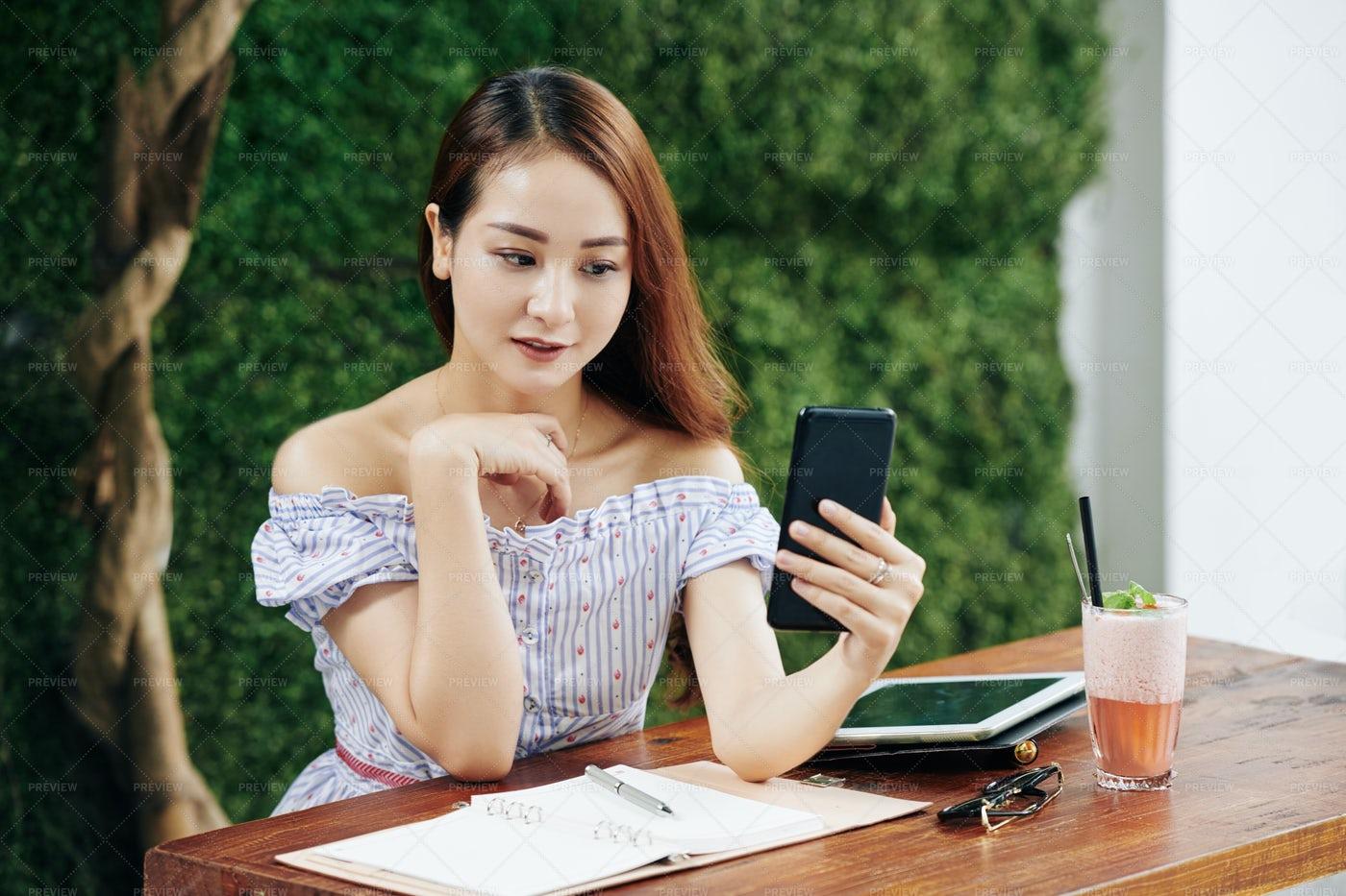 WOman Checking Social Media: Stock Photos