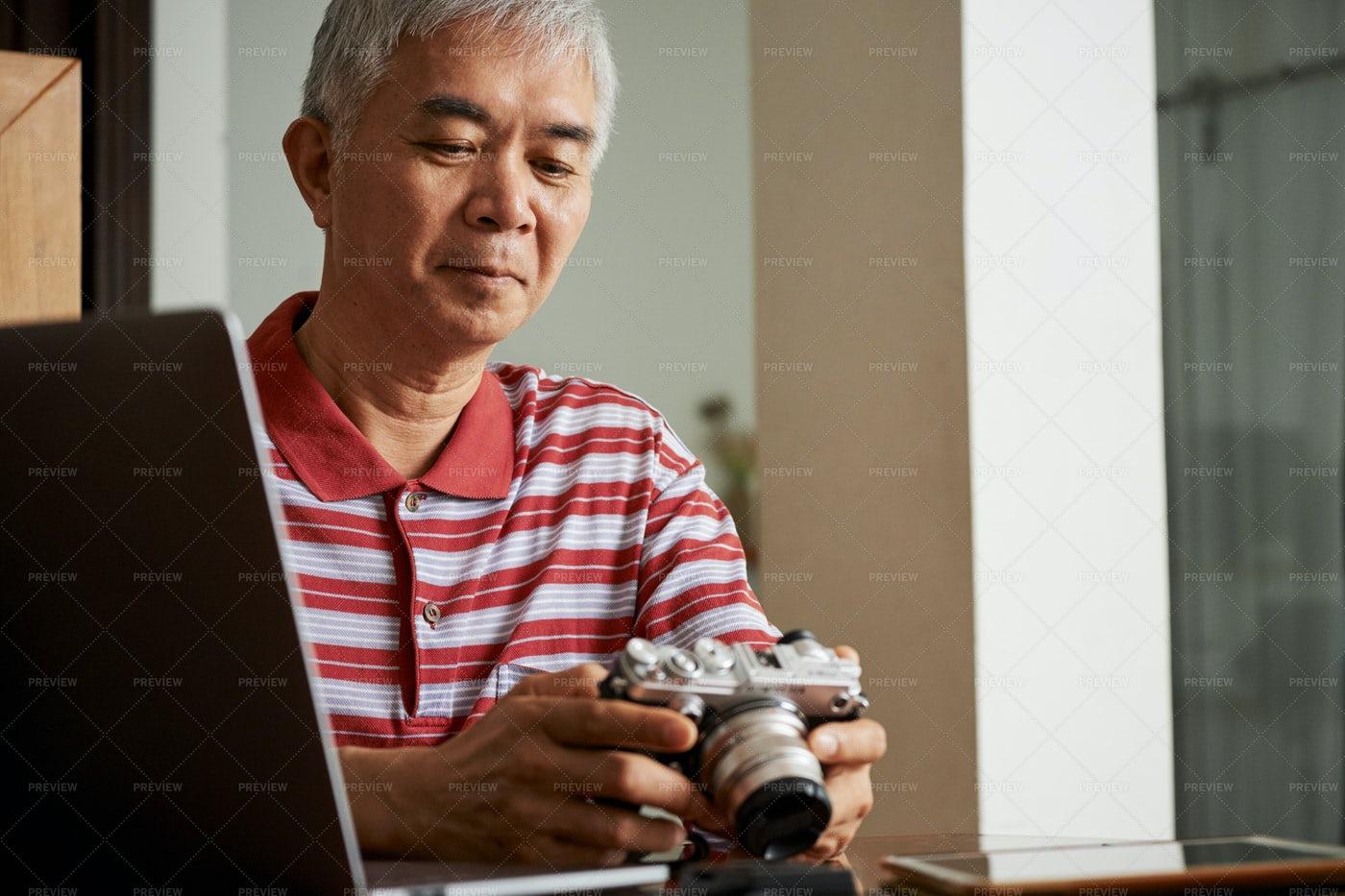 Man Working With Photos After Shooting: Stock Photos