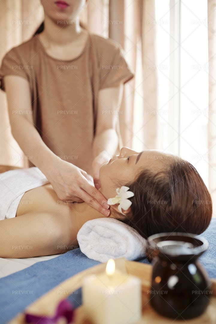Masseur Touching Pulse Of Female Client: Stock Photos