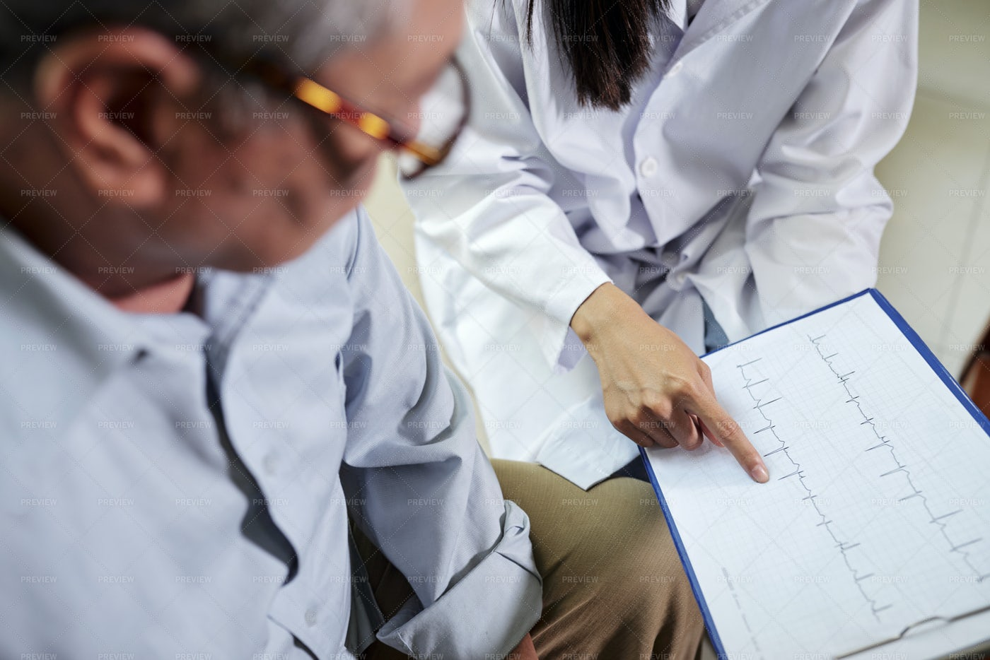 Cardiologist Showing Cardiogram To: Stock Photos