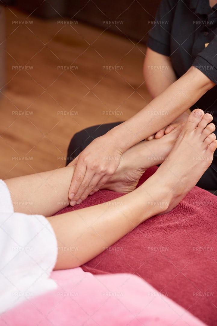Woman Getting Feet Massage: Stock Photos