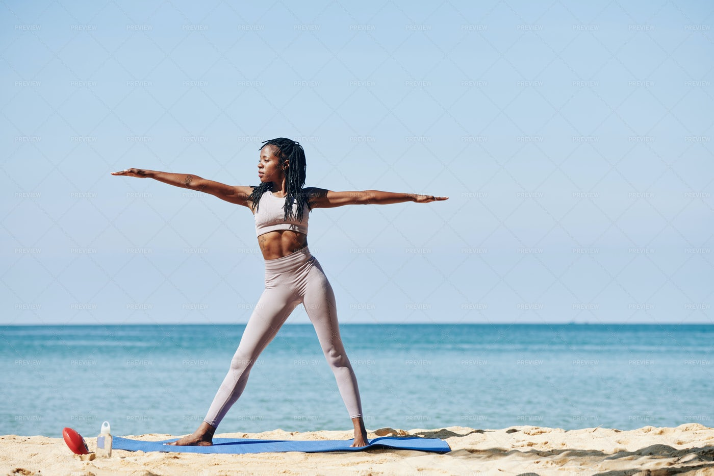 Young Woman In Warrior Pose: Stock Photos
