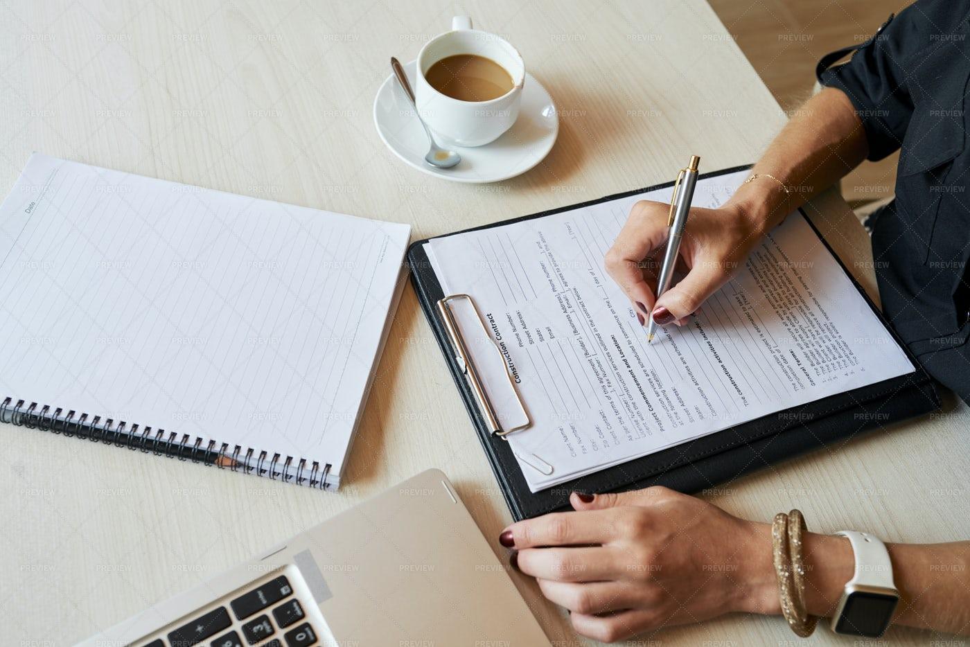 Female Entrepreneur Filling Document: Stock Photos