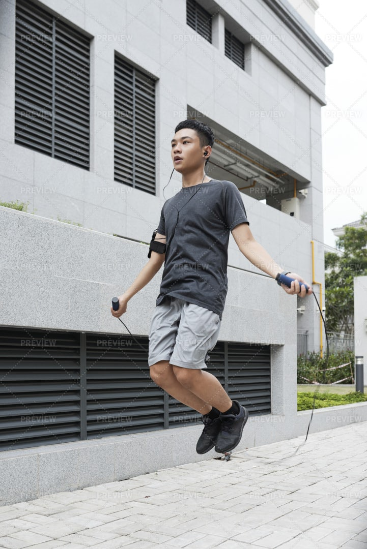 Jumping Asian Man: Stock Photos
