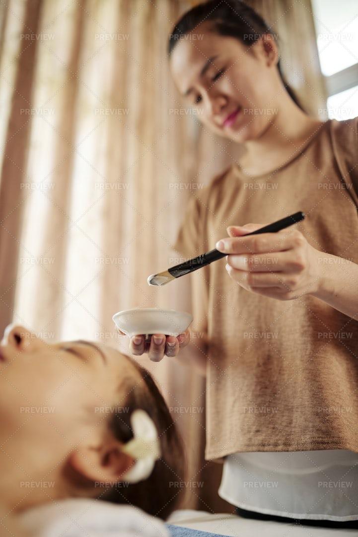 Cosmetologist Applying Liquid Clay Mask: Stock Photos