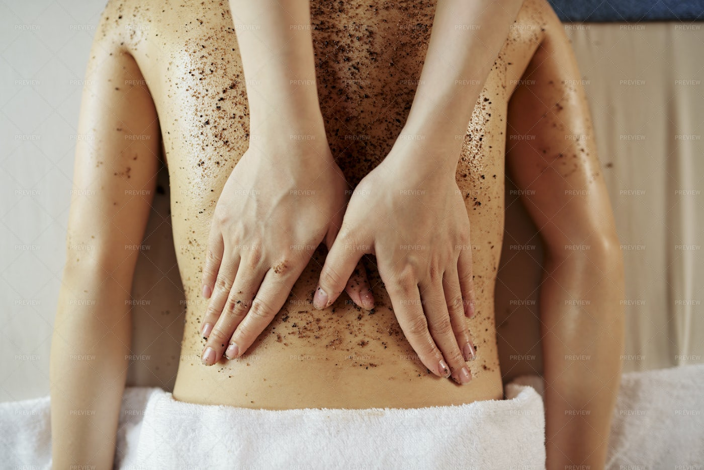Beautician Applying Body Scrub: Stock Photos