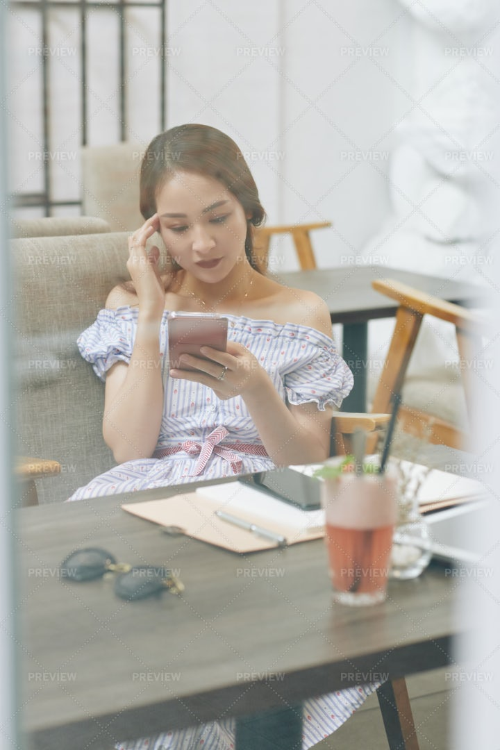 Woman Concentrated On Reading Online: Stock Photos