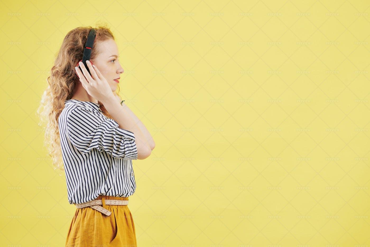 Young Woman Listening Audiobook: Stock Photos