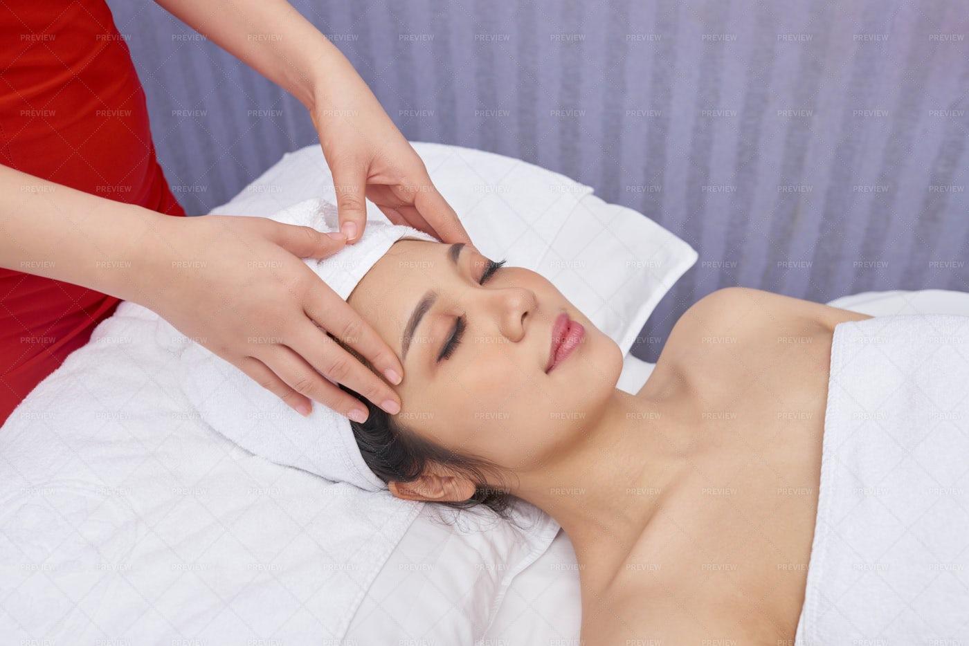 Face Massage At Beauty Salon: Stock Photos