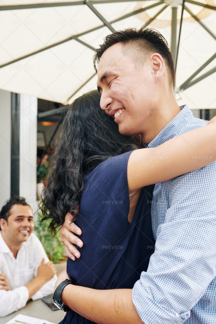 Cheerful Man Hugging Female Friend: Stock Photos
