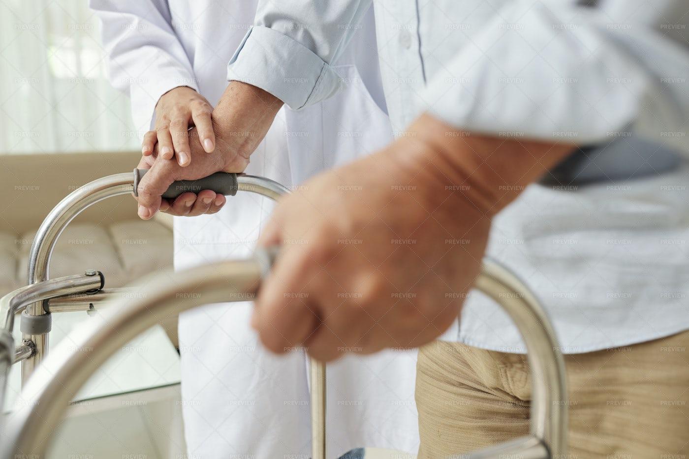Nurse Helping Senior Man At Hospital: Stock Photos