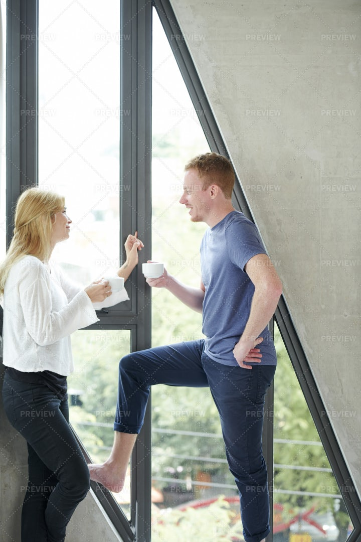 Cheerful Couple At Big Window: Stock Photos