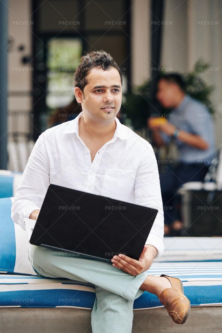 Pensive Indian Businessman With Laptop: Stock Photos