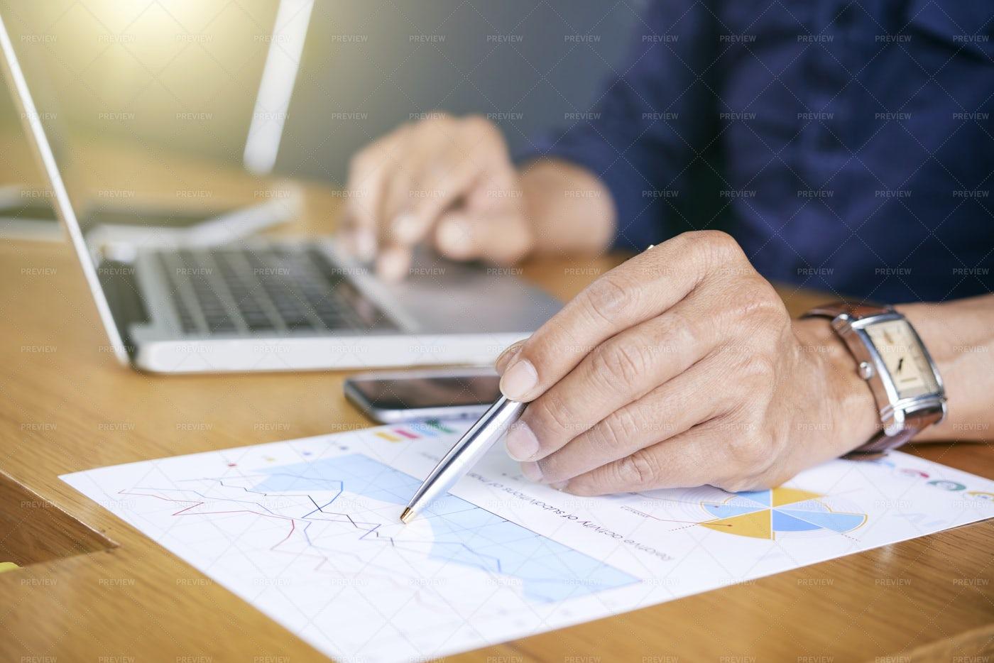 Businessman Examining Business: Stock Photos