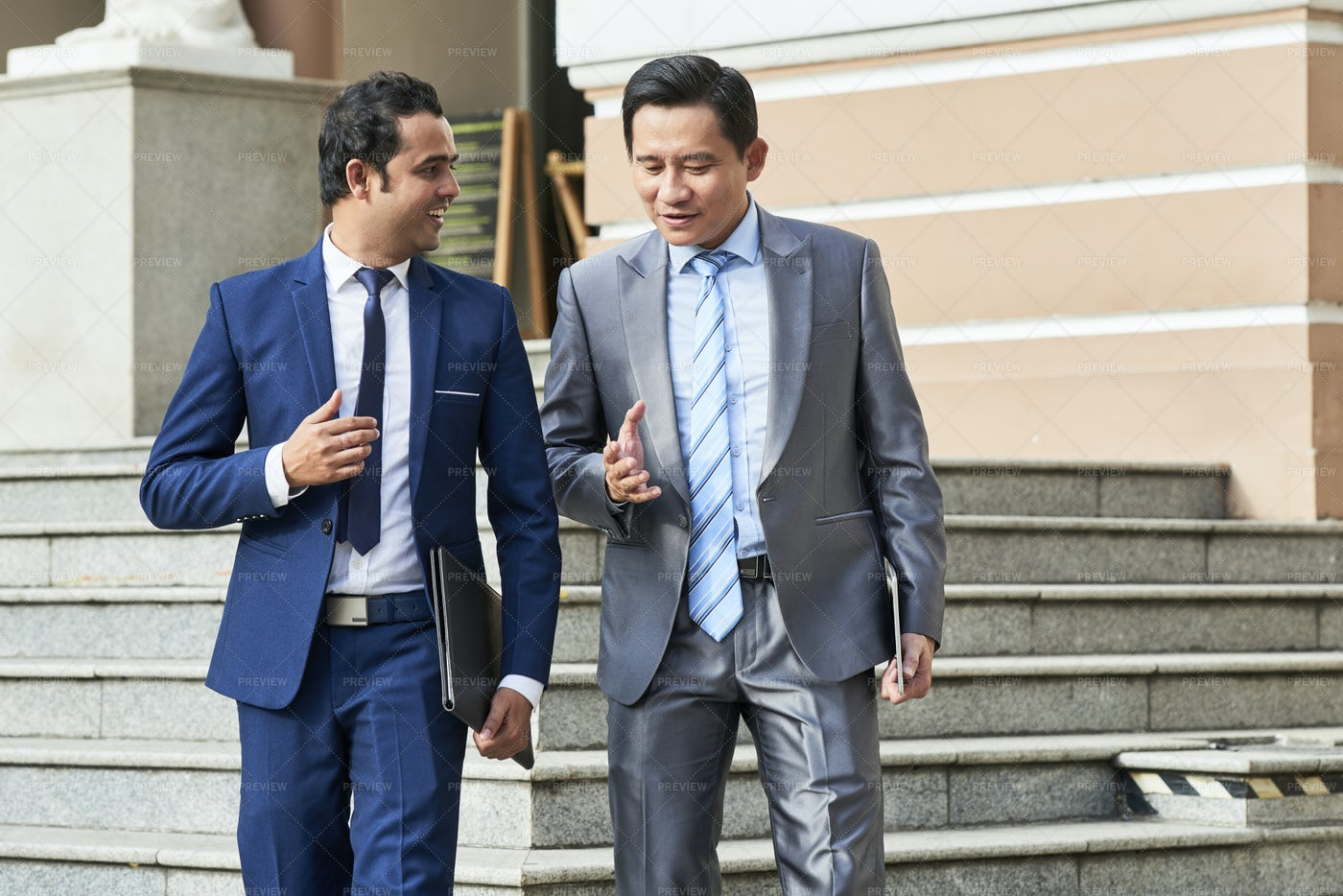 Two Businessmen Getting Out Of The: Stock Photos