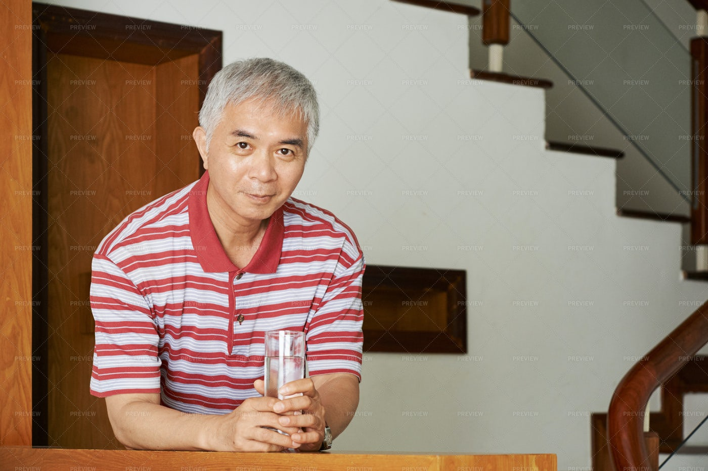 Asian Man With Glass Of Water: Stock Photos