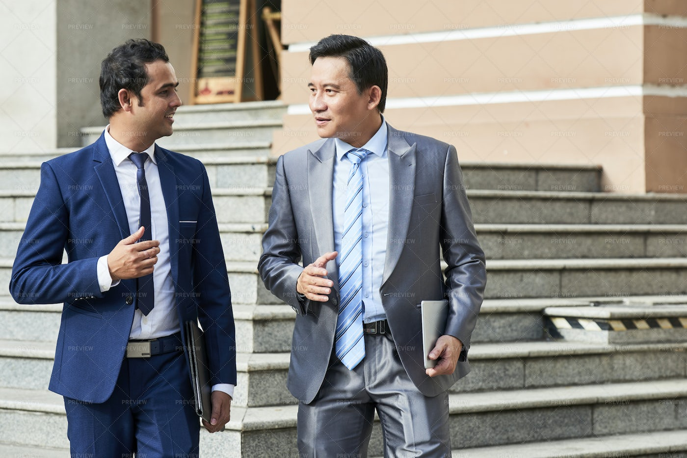 Business Colleagues Walking In The City: Stock Photos