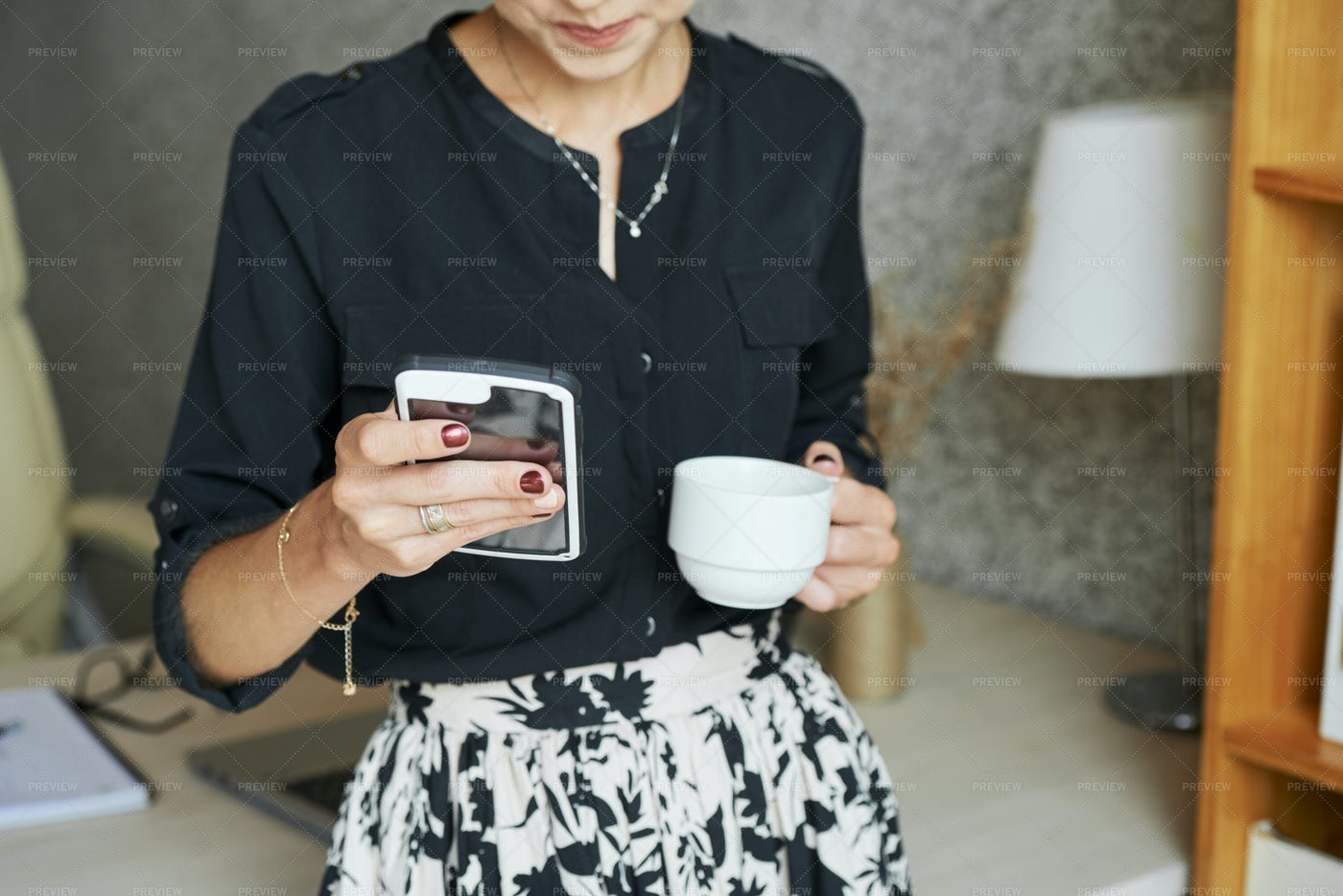 Woman Drinking Coffee And Checking: Stock Photos