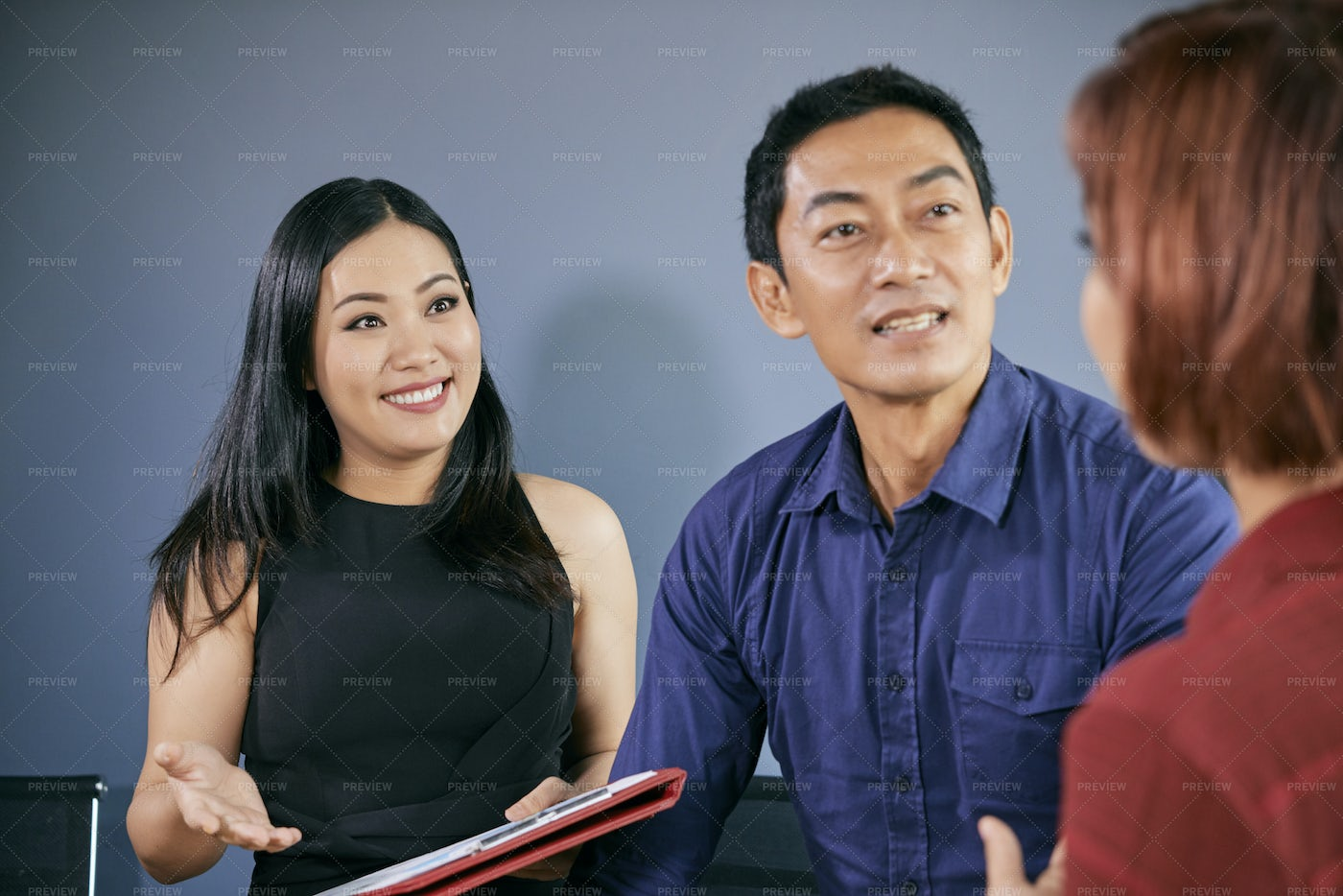 Business Partners Talking To The Client: Stock Photos