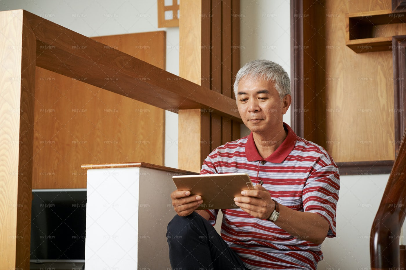 Man Sitting On Stairs With Tablet Pc: Stock Photos