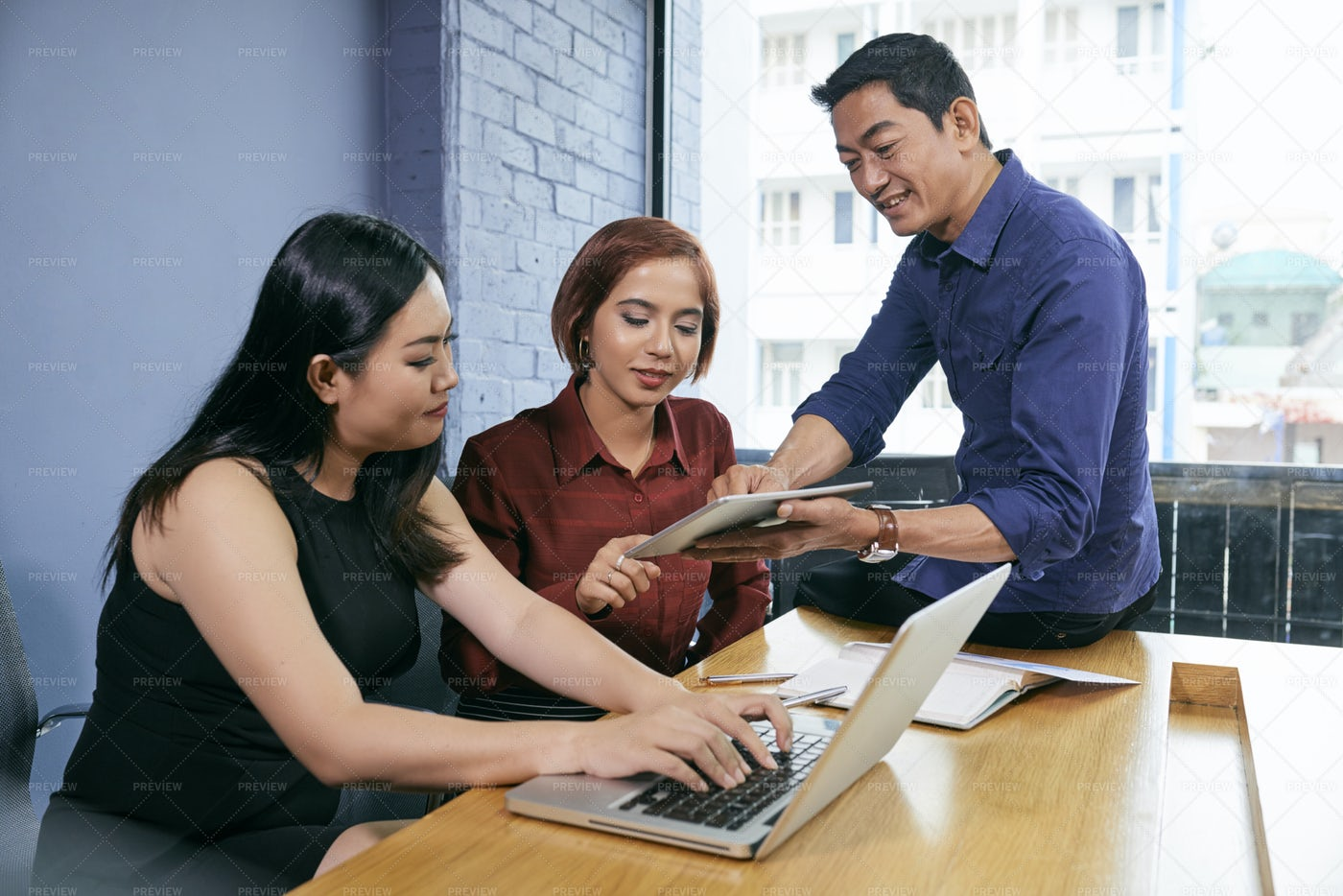 Business Team Using Modern Devices In: Stock Photos