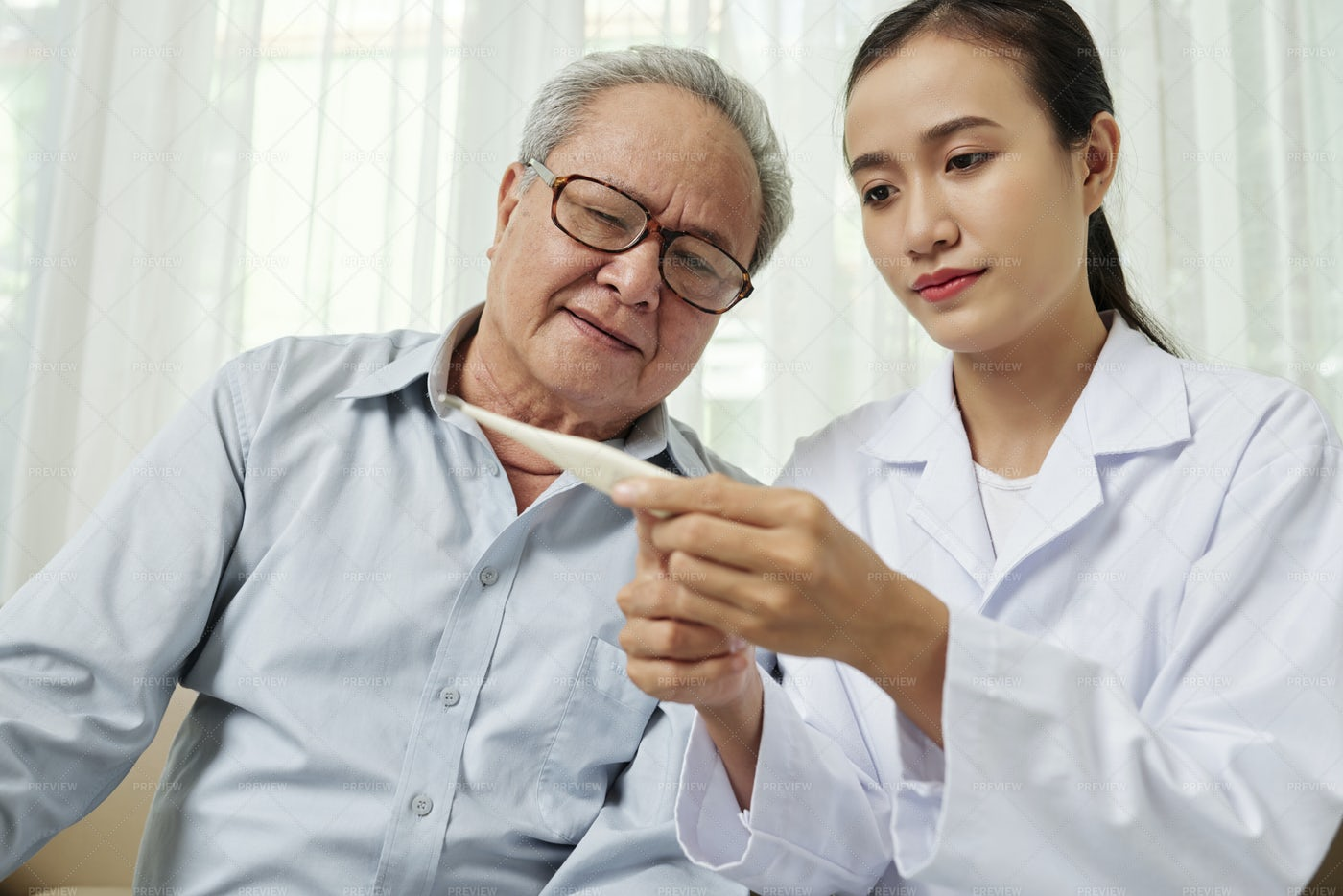 Doctor Controlling The Temperature Of: Stock Photos