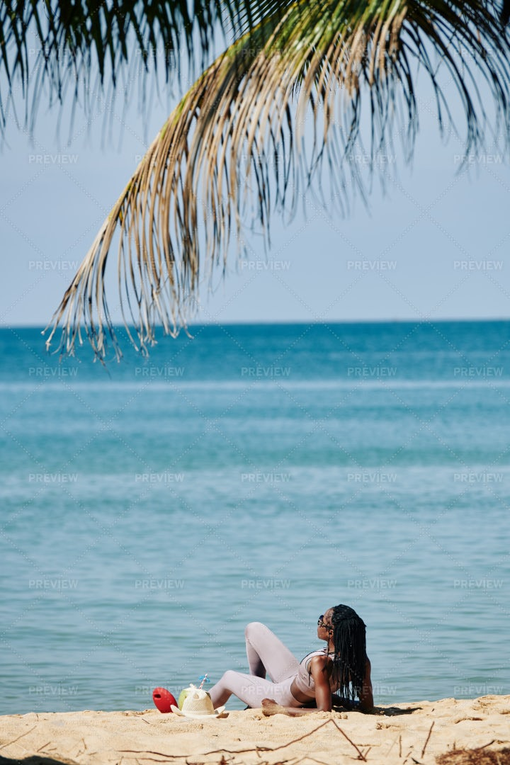 Sportswoman Resting On Beach: Stock Photos