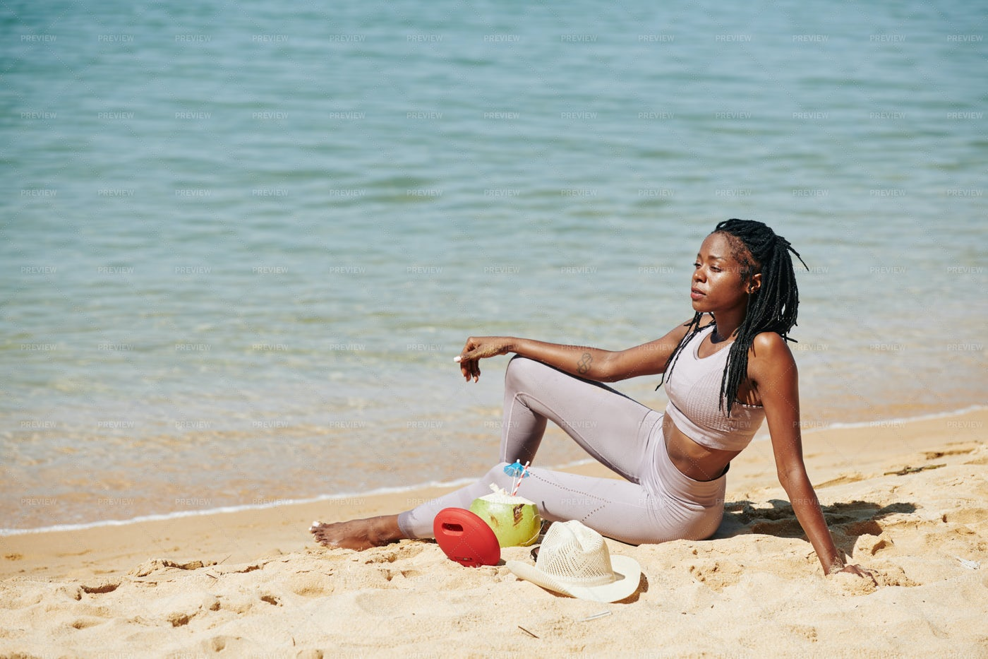 Sporty Woman Looking At Ocean: Stock Photos