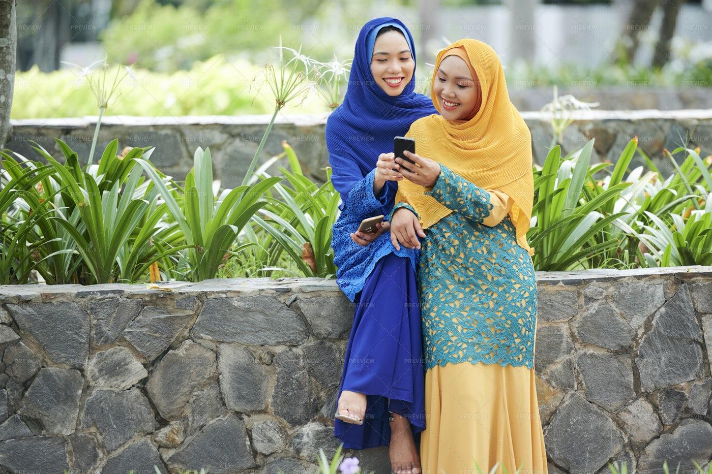 Muslim Female Friend With Smartphone: Stock Photos