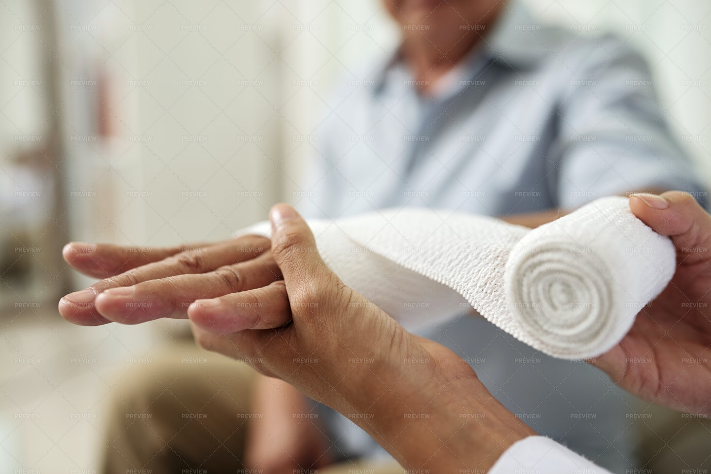 Doctor Putting Bandage On Patient's: Stock Photos