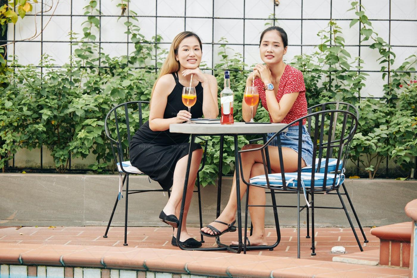 Beautiful Women Drinking Wine In Cafe: Stock Photos