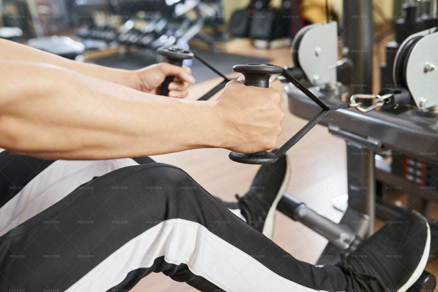 Man Exercising On Sport Equipment: Stock Photos