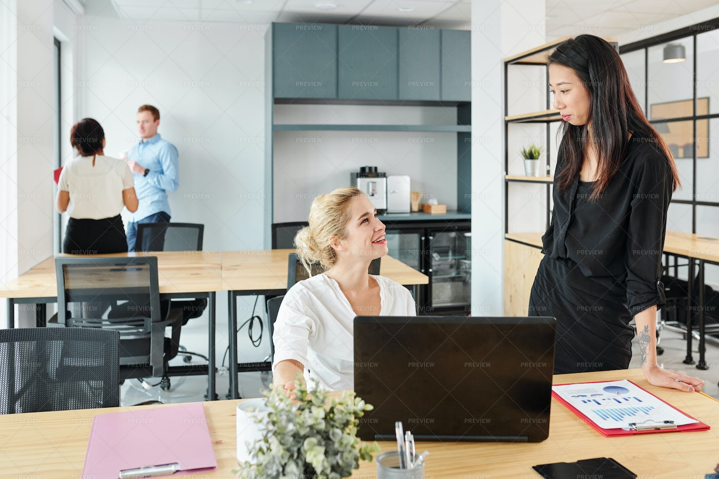Business Colleagues Cooperating At: Stock Photos